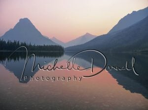Wildfire smoke makes sunset at Two Medicine, Glacier National Park, Montana, glow pink. Reflections off of Two Medicine Lake. 72 dpi, 300 dpi