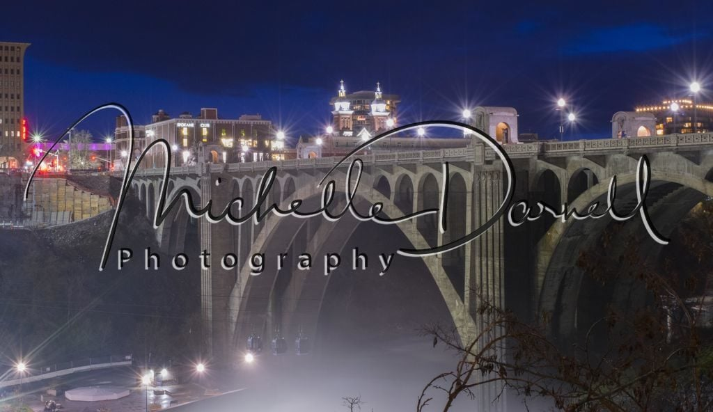 The Monroe Street bridge looms over the Spokane Falls gondola ride at night in downtown Spokane, Washington. 72 dpi, 300 dpi, 600 dpi